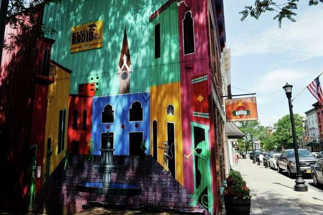 A view of the mural on the outside of the Mexican Radio restaurant on Warren St. on Thursday, June 25, 2015, in Hudson, N.Y.  (Paul Buckowski / Times Union) Photo: PAUL BUCKOWSKI / 00032353A