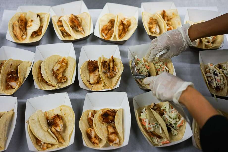 Fish tacos, made with local underutilized fish like grenadier, are prepared for the lunch line at Monterey High School. Photo: James Tensuan, Special To The Chronicle