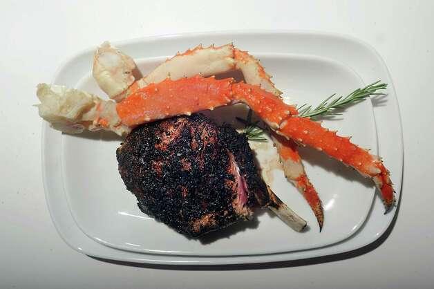 A 21 oz. bone-in cowboy ribeye and Alaskan king crab legs at Black & Blue Steak and Crab on Tuesday, July 21, 2015 in Albany, N.Y.  (Lori Van Buren / Times Union) Photo: Lori Van Buren / 00032683A