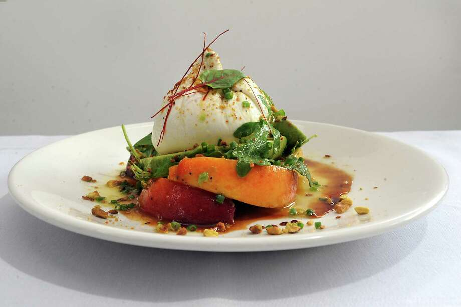 Maple Brook Farms Buratta with marinated peaches, avocados, wild arugula, toasted pistachios and lemon-lime honey dressing at 15 Church restaurant on Tuesday, July 21, 2015 in Saratoga Springs, N.Y.  (Lori Van Buren / Times Union) Photo: Lori Van Buren / 00032685A