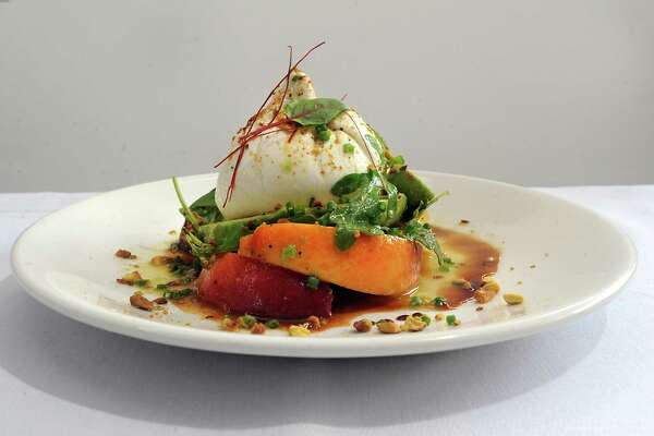 Maple Brook Farms Buratta with marinated peaches, avocados, wild arugula, toasted pistachios and lemon-lime honey dressing at 15 Church restaurant on Tuesday, July 21, 2015 in Saratoga Springs, N.Y.  (Lori Van Buren / Times Union)