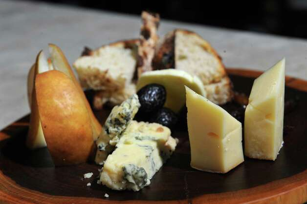 Cheese plate with English stilton and Bodensee butterkase at Rare Earth Wine Bar on Wednesday, Feb. 26, 2014 in Glens Falls, N.Y.  (Lori Van Buren / Times Union) ORG XMIT: MER2014022710251861 Photo: Lori Van Buren / 00025903A
