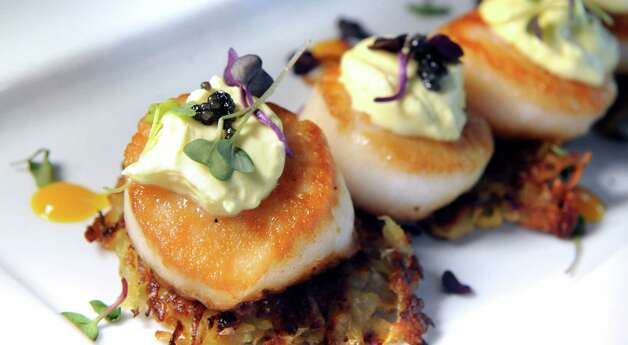Pan-seared Scallops over potato latkes and topped with mango creme fraiche on Friday, July 24, 2015, at Max London's in Saratoga Springs, N.Y. (Cindy Schultz / Times Union) Photo: Cindy Schultz / 00032745A