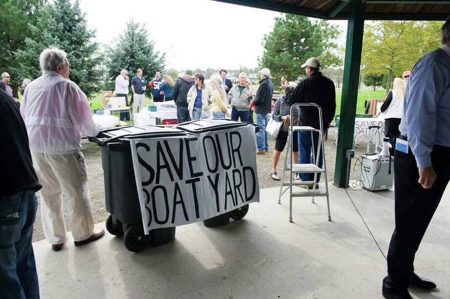 Residents rallied in Kosciuszko Park in October 2011 to save the city's boatyard. Harbor Point developer Building and Land Technology later demolished it, and has been haggling with the city since on how to replace it. Photo: Keelin Daly / Hearst Connecticut Media / Stamford Advocate