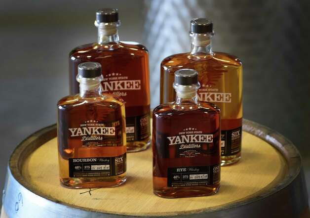 Yankee Distllery's product line is set out for all to see at the grand opening Thursday afternoon July 23, 2015 in Clifton Park, N.Y.  (Skip Dickstein/Times Union) Photo: SKIP DICKSTEIN / 00032589A