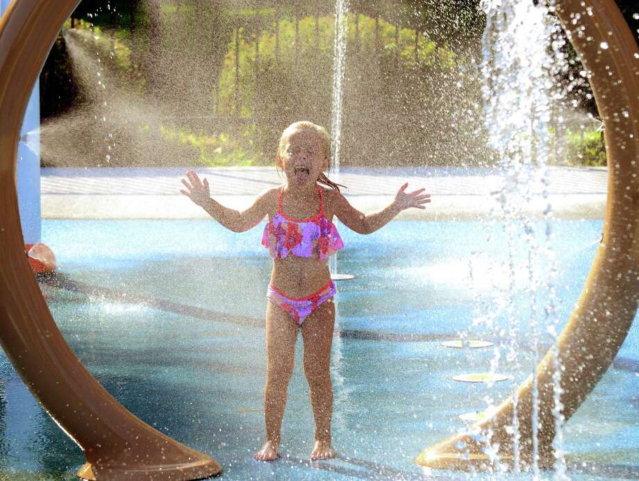 Kalina Jasinski, 4, plays at the water park at Longbrook Park in Stratford, Conn., on Tuesday Aug. 25, 2015. August is turning out to be one of the hottest months on record. Photo: Christian Abraham, Hearst Connecticut Media / Connecticut Post