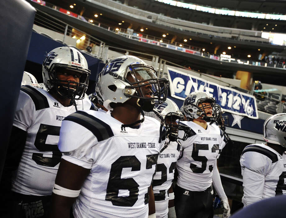 The Mustangs prepare to enter AT&T Stadium for Friday's championship game against the Gilmer Buckeyes. The West Orange-Stark Mustangs played the Gilmer Buckeyes for the 4A Division II championship title Friday at AT&T Stadium in Arlington, Texas. Photo taken Friday 12/19/14 Jake Daniels/The Enterprise Photo: Jake Daniels / ©2014 The Beaumont Enterprise/Jake Daniels