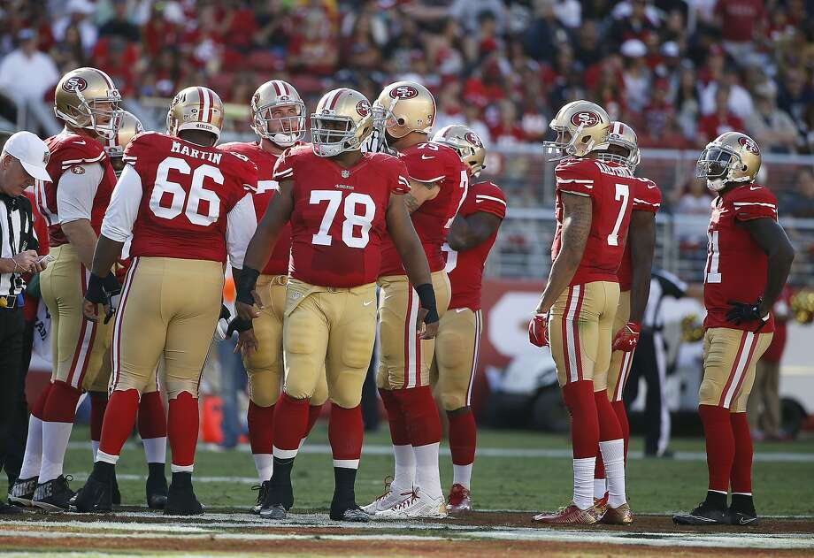 49ers center Marcus Martin (66) and guard Joe Looney (78) were shuffled around in practice after some offensive-line misplays against the Cowboys on Sunday. Photo: Tony Avelar, Associated Press