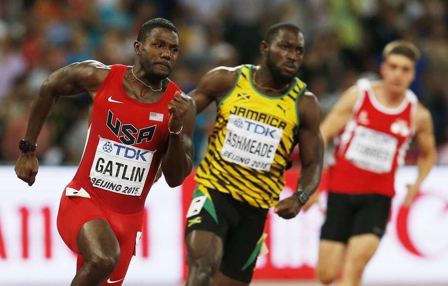 American Justin Gatlin races in a Round 1 heat alongside Jamaica's Nickel Ashmeade in the men's 200 meters. Photo: Mark Schiefelbein, Associated Press
