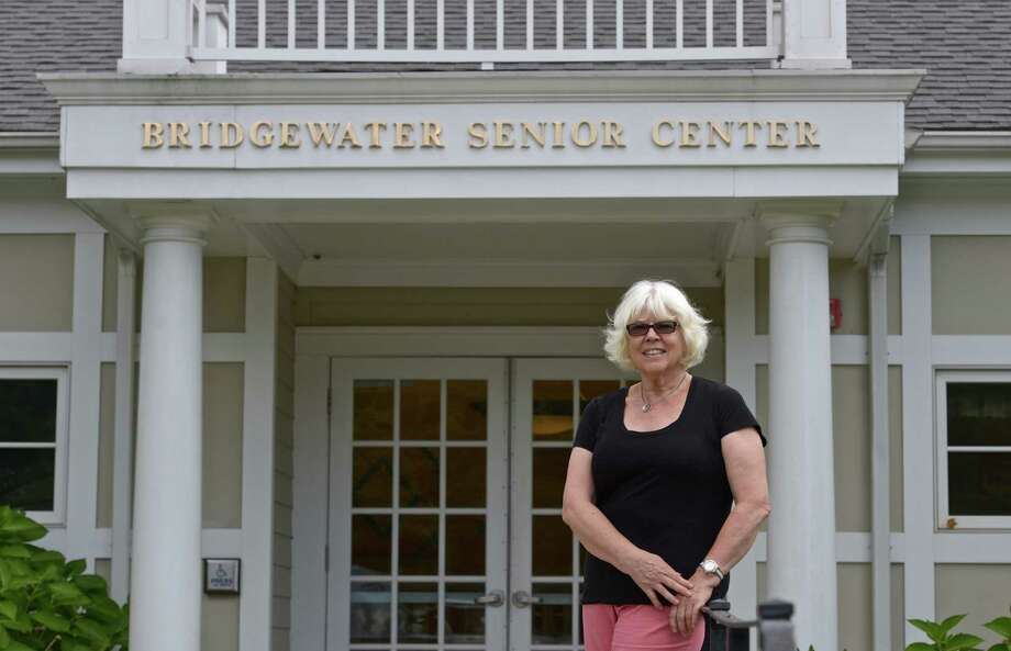 Marilyn Curtin, Director of the Bridgewater Senior Center stands in front of the entrance to the center. The center is planning to expand their building with a 900-sq-foot addition on the rear of the building. They also plan on adding a heated entry way. Tuesday, August 25, 2015, in Bridgewater, Conn. Photo: H John Voorhees III / Hearst Connecticut Media / The News-Times