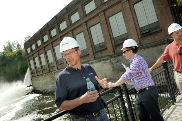 John McVaigh, senior operations manager of Brookfield Renewable Energy Group, gives a tour on Tuesday, Aug. 25, 2015, at the School Street Hydroelectric Facility in Cohoes, N.Y. (Cindy Schultz / Times Union) Photo: Cindy Schultz / 00033097A