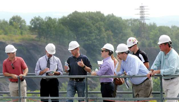 John McVaigh, senior operations manager of Brookfield Renewable Energy Group, third from left, gives a tour on Tuesday, Aug. 25, 2015, at the School Street Hydroelectric Facility in Cohoes, N.Y. (Cindy Schultz / Times Union) Photo: Cindy Schultz / 00033097A