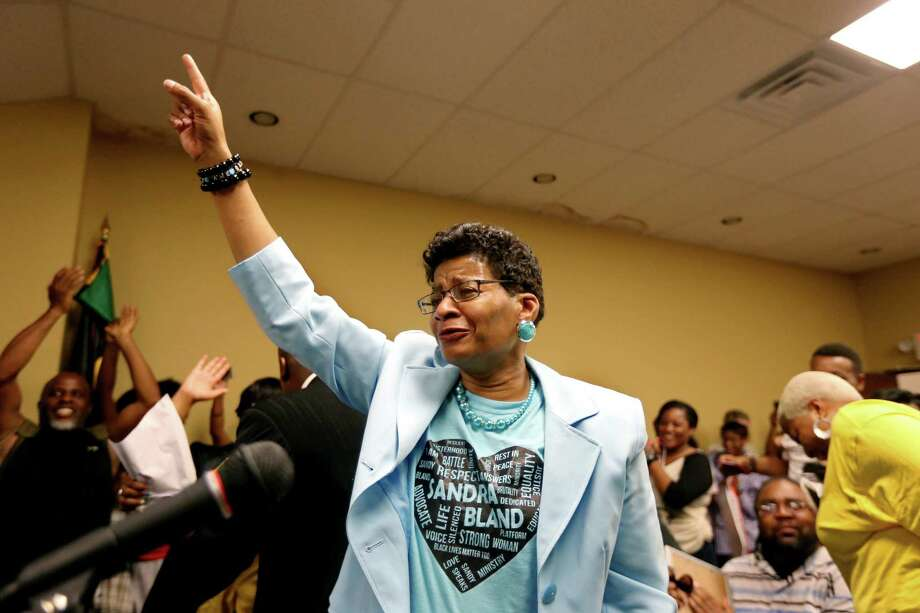 Geneva Reed-Veal, center, of Chicago, mother of Sandra Bland, reacts after Prairie View City Council members voted to rename a portion of University Boulevard to Sandra Bland Parkway on Tuesday. Photo: Gary Coronado, Houston Chronicle / © 2015 Houston Chronicle