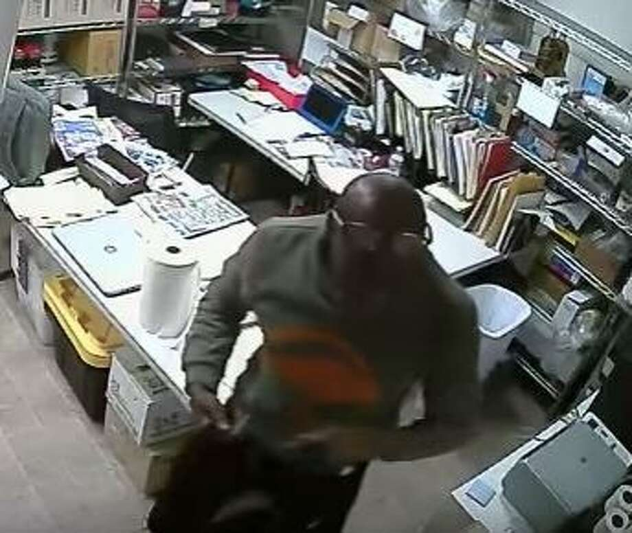A burglary suspect was caught on video making off with more than $30,000 in cash from an unlocked lock box at a produce market in San Francisco Aug. 13, 2015. Photo: Courtesy, San Francisco Police Department