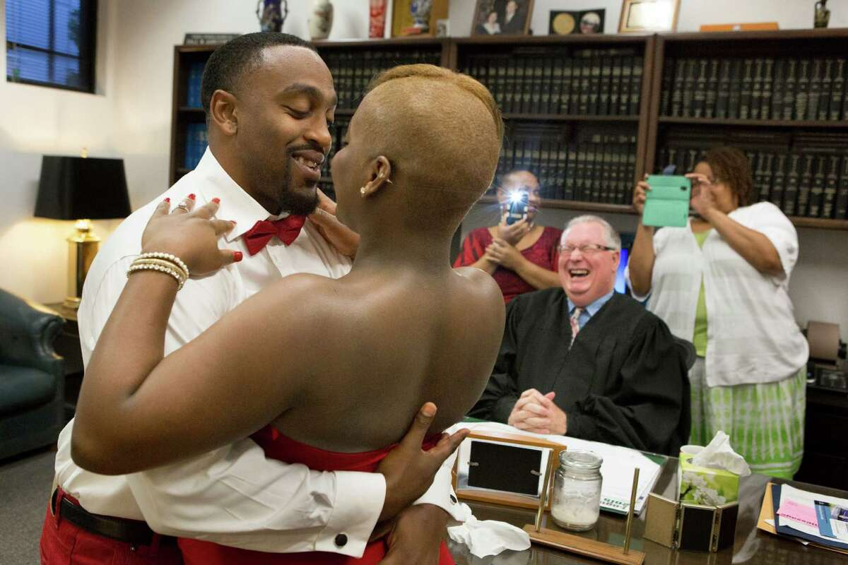 Kedrick Kelly kisses his wife Jessica McDowell after Judge Dale Gorczynski united them in matrimony on Friday. The judge's daughter married her wife in Maine.