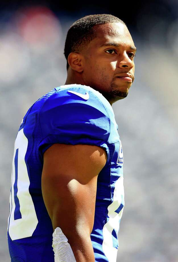 EAST RUTHERFORD, NJ - SEPTEMBER 14:  Wide receiver Victor Cruz #80 of the New York Giants looks on prior to a game against the Arizona Cardinals at MetLife Stadium on September 14, 2014 in East Rutherford, New Jersey.  (Photo by Alex Trautwig/Getty Images) ORG XMIT: 504251767 Photo: Alex Trautwig / 2014 Getty Images