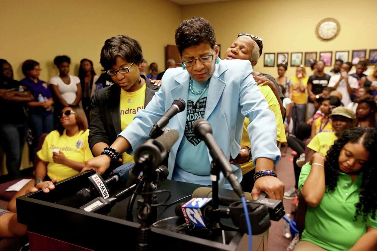 Geneva Reed-Veal, mother of Sandra Bland, is supported by her daughters Sharon Cooper, left, and Shante Needham while speaking at a Prairie View City Council meeting in favor of renaming a stretch of road after Bland.