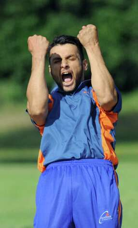 Excelsior's Javed Safi reacts to a teammate's catch during their semifinal cricket game against Tri-City on Saturday, Aug. 22, 2015, at Grout Athletic Field in Schenectady, N.Y. (Cindy Schultz / Times Union) Photo: Cindy Schultz / 00033027A