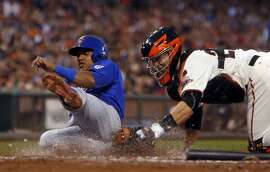 Chicago Cubs' Starlin Castro is tagged out by San Francisco Giants' Buster Posey on Dexter Fowler's fielder's choice in 3rd inning during MLB game at AT&T Park in San Francisco, Calif., on Tuesday, Aug. 25, 2015.