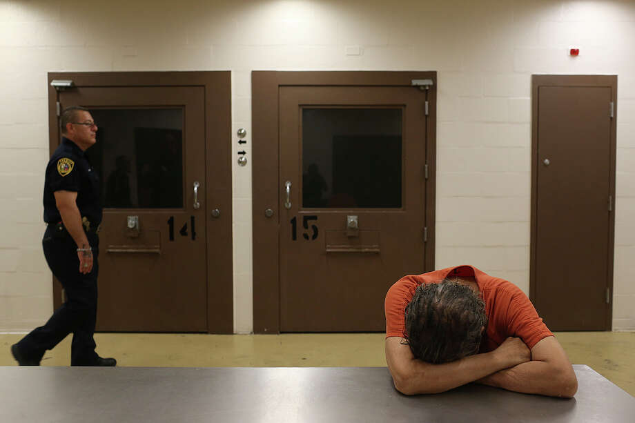 An inmate rests on a table in the mental health unit at Bexar County Jail.   2015. The unit was remodeled after officials at the jail commissioned a report from national suicide prevention expert  2010. Photo: Jerry Lara / San Antonio Express-News / © 2015 San Antonio Express-News