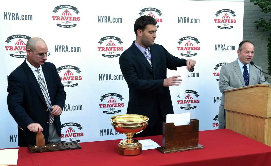 Members of the Racing Office pull the pills at the Post Position Draw which place the horse with placement in the starting gate Tuesday evening Aug. 25, 2015 in Saratoga Springs, N.Y.    (Skip Dickstein/Times Union) Photo: Skip Dickstein / 00033122A