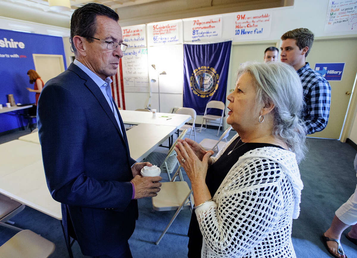 Connecticut Governor Dannel Malloy speaks with Joanne St. John of Nashua, NH following a round table on gun control at Hillary Clinton's Manchester, NH headquarters on Tuesday, August 25, 2015.