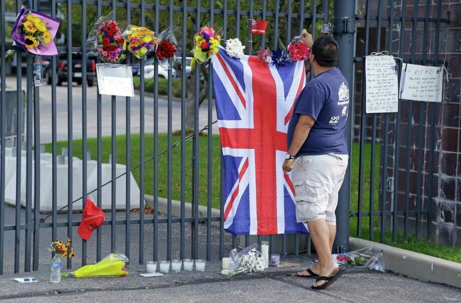 Jerry Perez, of Indianapolis, places a flower on the main gate of the Indianapolis Motor Speedway in a memorial to race driver Justin Wilson, of England, Tuesday, Aug. 25, 2015, in Indianapolis.  Wilson died from a head injury suffered when a piece of debris struck him at Pocono Raceway. He was 37. (AP Photo/Michael Conroy) ORG XMIT: INMC102 Photo: Michael Conroy / AP