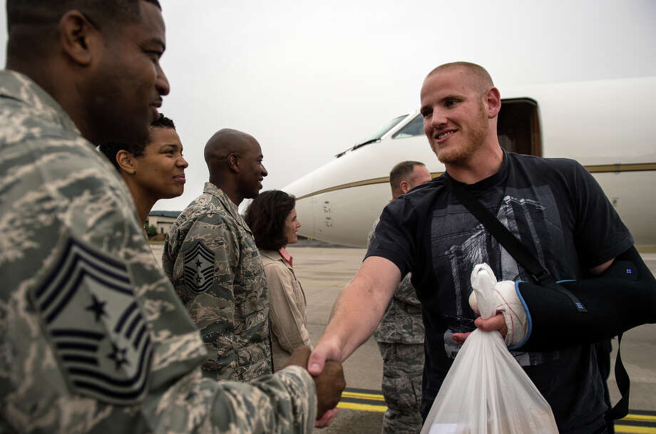 In this Aug. 24, 2015 picture, provided by U.S, Airforce Ramstein ,  Air Force Airman 1st Class Spencer Stone , right, meets Chief Master Sgt. Phillip Easton, 86th Airlift Wing command chief, upon his arrival to Ramstein Air Base, Germany. Stone, along with childhood friends Aleksander Skarlatos and Anthony Sadler, was recently honored by French President Francois Hollande with the French Legion of Honour for subduing an armed gunman when he entered their train carrying an assault rifle, a handgun and a box cutter. Stone is an ambulance service technician with the 65th Medical Operations Squadron stationed at Lajes Field, Azores. (Staff Sgt. Sara Keller/U.S. Air Force via AP) MANDATORY CREDIT ORG XMIT: XRAM101 Photo: Sara Keller / U.S. Air Force Ramstein