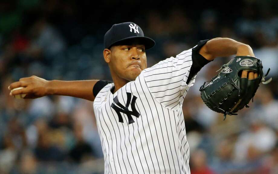 New York Yankees starting pitcher Ivan Nova winds up during the first inning of a baseball game against the Houston Astros at Yankee Stadium in New York, Tuesday, Aug. 25, 2015. Nova allowed five runs in the inning. (AP Photo/Kathy Willens) ORG XMIT: NYY104 Photo: Kathy Willens / AP
