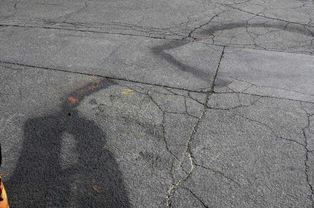 Blood and paint marks are seen on a parking lot in the rear of Jimmy's Pizzeria on Tuesday, Aug. 25, 2015 in Lansingburgh, N.Y. A shoot-out between Troy police officers, Joshua Comitale and Chad Klein and 39-year-old Thaddeus Faison of Albany took place Saturday night. Faison was shot repeatedly near the intersection of 112th Street and Fifth Avenue by at least one of the officers and was later pronounced dead at St. Mary's Hospital. (Lori Van Buren / Times Union) Photo: Lori Van Buren / 00033124A