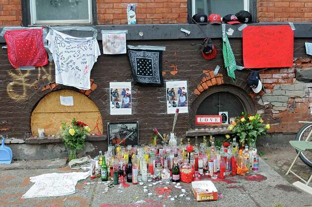 """A memorial is set up near the corner of Glen Ave. and 7th Ave. for Thaddeus """"T.O."""" Faison on Tuesday, Aug. 25, 2015 in Lansingburgh, N.Y.  A shoot-out between Troy police officers, Joshua Comitale and Chad Klein and 39-year-old Thaddeus Faison of Albany took place Saturday night. Faison was shot repeatedly near the intersection of 112th Street and Fifth Avenue by at least one of the officers and was later pronounced dead at St. Mary's Hospital. (Lori Van Buren / Times Union) Photo: Lori Van Buren / 00033124A"""