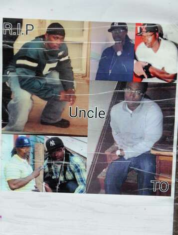 """Photos at a memorial set up near the corner of Glen Ave. and 7th Ave. for Thaddeus """"T.O."""" Faison on Tuesday, Aug. 25, 2015 in Lansingburgh, N.Y.  A shoot-out between Troy police officers, Joshua Comitale and Chad Klein and 39-year-old Thaddeus Faison of Albany took place Saturday night. Faison was shot repeatedly near the intersection of 112th Street and Fifth Avenue by at least one of the officers and was later pronounced dead at St. Mary's Hospital. (Lori Van Buren / Times Union) Photo: Lori Van Buren / 00033124A"""