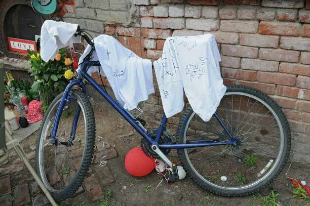 """A memorial is set up near the corner of Glen Ave. and 7th Ave. for Thaddeus """"T.O."""" Faison including his bike on Tuesday, Aug. 25, 2015 in Lansingburgh, N.Y.  A shoot-out between Troy police officers, Joshua Comitale and Chad Klein and 39-year-old Thaddeus Faison of Albany took place Saturday night. Faison was shot repeatedly near the intersection of 112th Street and Fifth Avenue by at least one of the officers and was later pronounced dead at St. Mary's Hospital. (Lori Van Buren / Times Union) Photo: Lori Van Buren / 00033124A"""