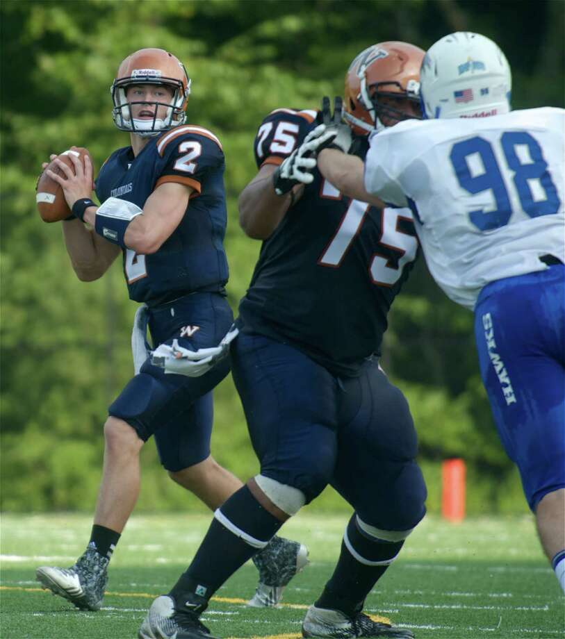 The Colonials quarterback Will Arndt, 2, looks downfield while being protected by offensive lineman Johnnie Medina, 75, Mike Simone, 98, of Hartwick College, during a football game between the Hawks, of Oneonta, NY, and the Western Connecticut State University Colonials, played at the WCSU Westside Athletic Complex, in Danbury, Conn, on Saturday, September, 6, 2014. Photo: H John Voorhees III / H John Voorhees III / The News-Times Freelance