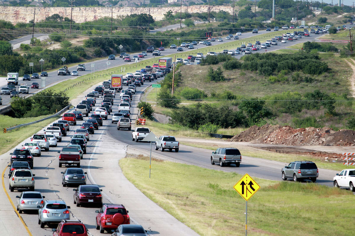 The afternoon rush hour starts and traffic snarls around the construction area of 281 and 1604 on the north side of San Antonio on August 22, 2012.