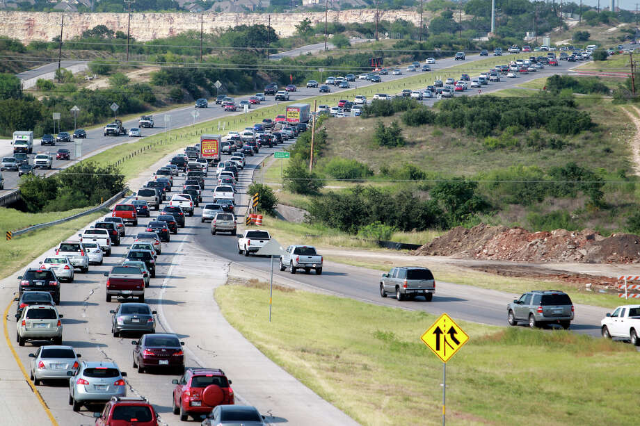 The afternoon rush hour starts and traffic snarls around the construction area of 281 and 1604 on the north side of San Antonio on August 22, 2012. Photo: Tom Reel, Staff / San Antonio Express-News / ©2012 San Antono Express-News