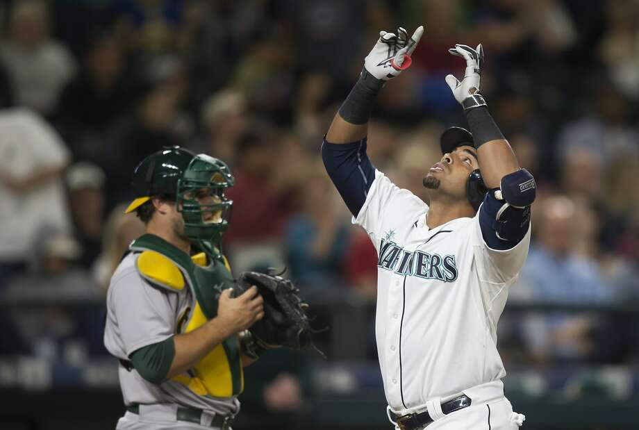 Seattle Mariners' Nelson Cruz celebrates hitting a solo home run during the fourth inning of a baseball game against the Oakland Athletics, Tuesday, Aug. 25, 2015, in Seattle. At left is catcher Josh Phegley. (AP Photo/Stephen Brashear) Photo: Stephen Brashear, Associated Press