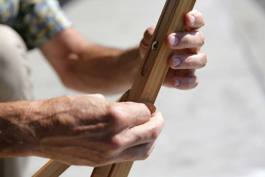 Howard Flax assembles an easel outside the space where his new arts and crafts store will be located in Fort Mason in San Francisco, California, on Tuesday, Aug. 25, 2015. Photo: Connor Radnovich, The Chronicle