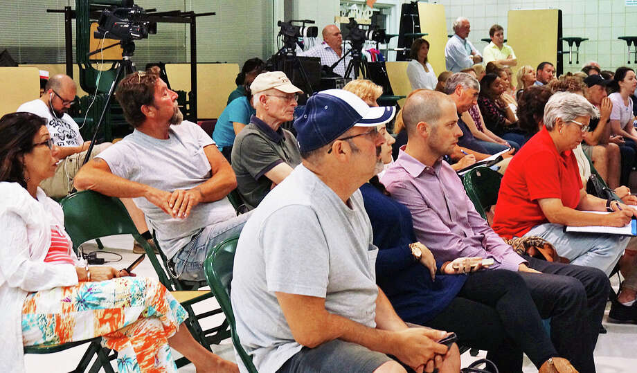 A large group of neighbors turned out to listen to the Town Plan and Zoning Commission's decision on a facility for young adults with autism. The TPZ denied the application for the Barberry Road property that is already home to Giant Steps. Photo: Genevieve Reilly / Fairfield Citizen / Fairfield Citizen