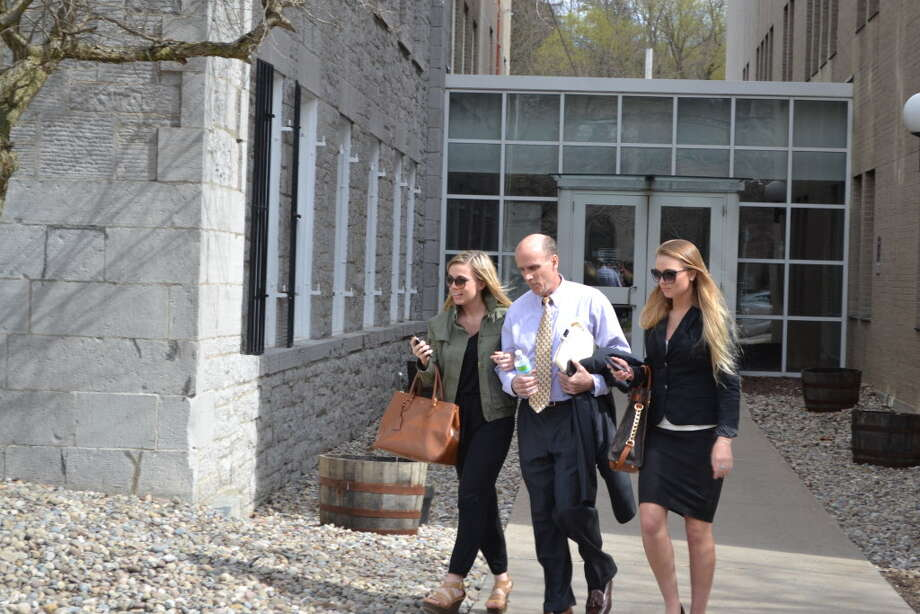 Cal Harris walks out of Schoharie County Court Tuesday, April 28, 2015, with his daughters Jenna and Cayla. The Tioga County man is accused of murdering his wife, Michele, on Sept. 11, 2001. Juries have twice convicted Harris of the murder, but both verdicts were reversed. (Keshia Clukey/ Times Union archive)