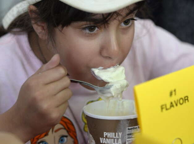 Angelina Angelone 11, of N. Providence, R.I., participates in the Stewart's ice cream eating contest Wednesday afternoon Aug. 20, 2014,  at the Saratoga Race Course in Saratoga Springs, N.Y.    (Skip Dickstein/Times Union archive) Photo: SKIP DICKSTEIN