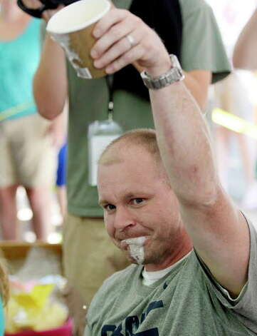 Josh Parkhurst, 38, of Rotterdam puts away a pint of Stewart's Philly Vanilla ice cream in a quick time of 41.1 seconds and won the Adult category during the annual Stewart's ice cream eating contest Aug 19, 2013 at the Saratoga Race Course in Saratoga Springs, N.Y.  The contest is held annually during Travers Stakes week at the Spa.   (Skip Dickstein/Times Union archive) Photo: SKIP DICKSTEIN