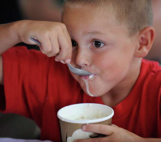Jack Leary, 7, works on a pint of Stewart's ice cream during the ice cream eating contest sponsored by Stewart's at the Saratoga Race Course in Saratoga Springs, New York (Skip Dickstein / Times Union archive) Photo: SKIP DICKSTEIN / 2008