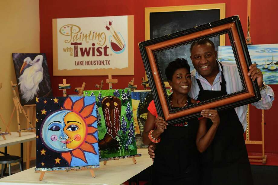 Painting with a Twist franchise owners Kermie, left, and Algy Irvin, show off their Kingwood studio on FM 1960 East.  The couple left New Orleans after Katrina and became successful business owners in Texas, with wine-friendly art classes in Kingwood and in The Woodlands. Photo: Jerry Baker, Freelance