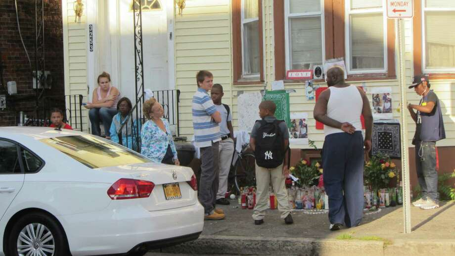 "People continue to gather at a memorial site for Thaddeus ""T.O."" Faison on Seventh Avenue in Troy on Wednesday, Aug. 27, 2015.  (Bob Gardinier/Times Union)"