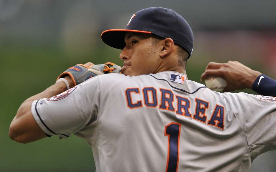 Astros shortstop Carlos Correa, the top overall pick in the 2012 draft, made his major-league debut June 8 against the White Sox at U.S. Cellular Field as the youngest player in the majors to begin his impressive bid to win the 2015 AL Rookie of the Year Award. Photo: PAUL BEATY, Associated Press