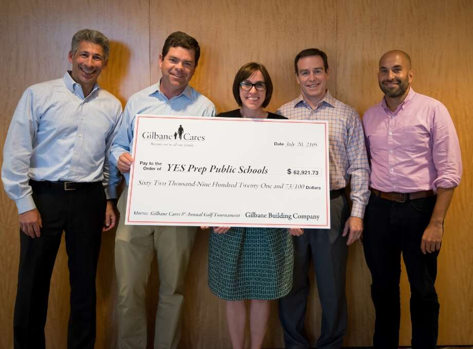 Gilbane Building Co. raised more than $203,000 during a charity golf tournament. The funds were donated to four Houston-area nonprofits, including YES Prep, a charter school. Pictured, left to right, are YES Prep's board chairman Joe Greenberg, board member Dan Gilbane, executive director Ann Ziker, board member Mickey Barrett, and superintendent Mark DiBella. Left to right:  Joe Greenberg, Board Chairman, Dan Gilbane, Board member, Ann Ziker Executive Director, Mickey Barrett, Board member, Mark DiBella, YES Prep Superintendent (PRNewsFoto/Gilbane Building Company) Photo: Gilbane Building Co, HO / Gilbane Building Company