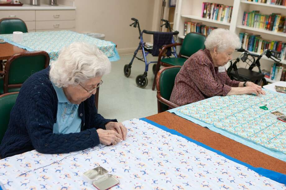 Jeannette Eaton and Anita Green of the senior quilting group at Parkway Place Senior Living Center, work on lap quilts.  The group donates quilts to other residents at the center and its associated hospice, and to needy children, and they sell a few to help cover expenses for fabrics, thread, and so on.   Photo By R. Clayton McKee Photo: R. Clayton McKee, Freelance / © R. Clayton McKee