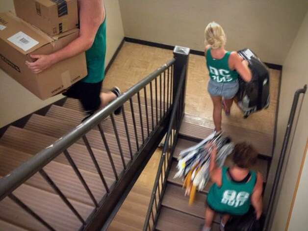 First-year students at Albany College of Pharmacy and Health Sciences moved into their dorm rooms on Wednesday, said good-bye to their families and began their college experiences. (Paul Buckowski / Times Union)