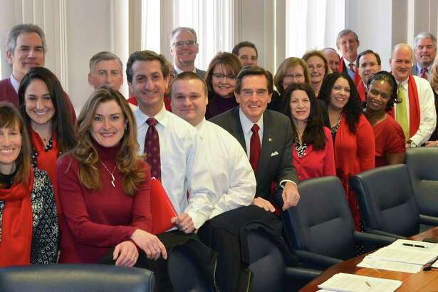 Webster bankers pose for a photo for National Wear Red Day, one of many community and philanthropic causes that Webster supports.